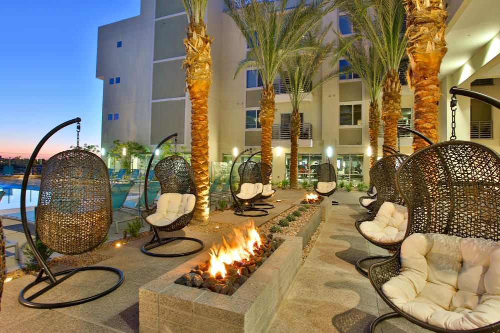 Fire pits and swinging chairs at dusk at Slate Scottsdale in Phoenix, Arizona