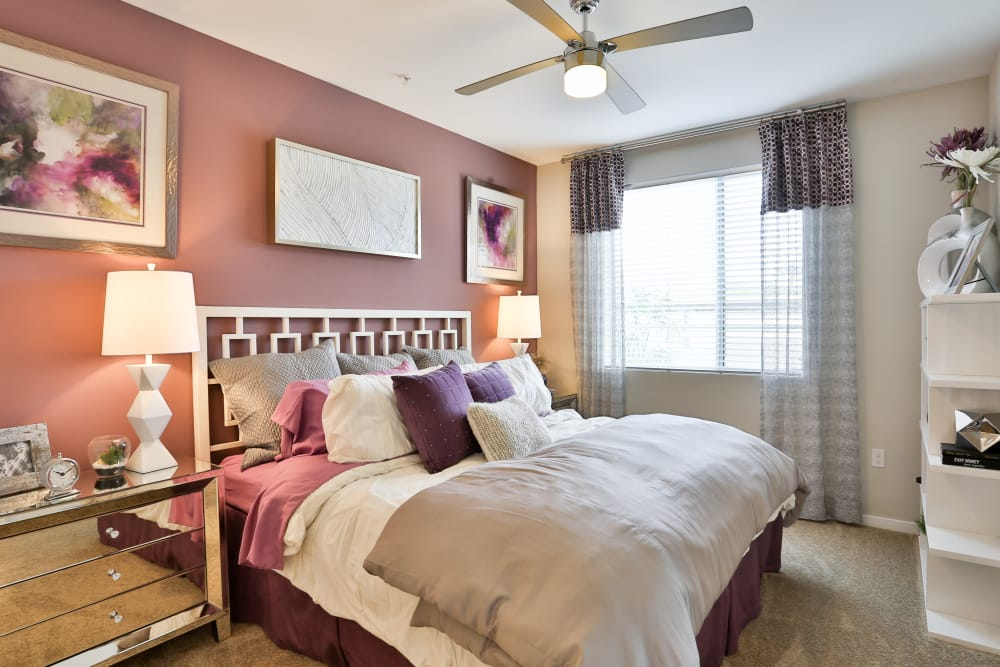 Ceiling fan and accent wall in bedroom of model home at Slate Scottsdale in Phoenix, Arizona