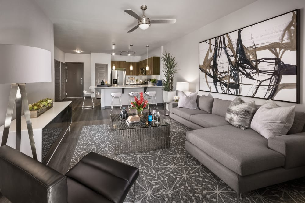Large living room with ceiling fan and beautiful furnishings in model home at Aviva in Mesa, Arizona