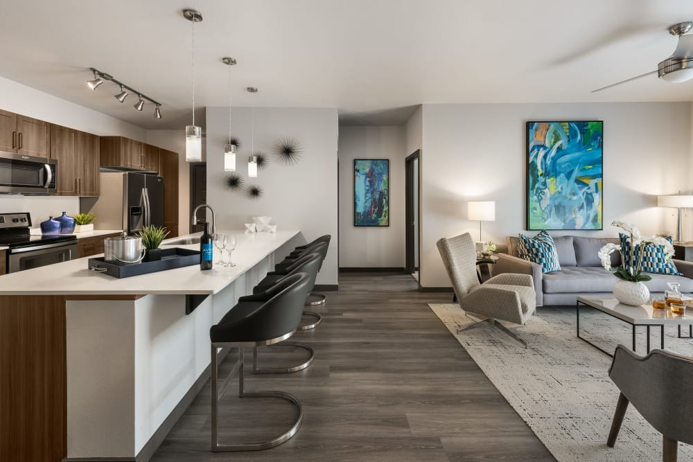 Beautiful open-concept floor plan with hardwood floors in model home at Aviva in Mesa, Arizona