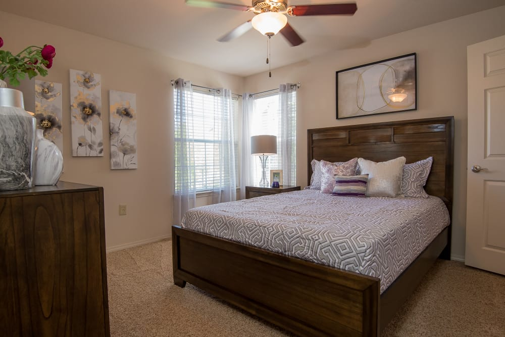 A well decorated bedroom at Villas at Aspen Park in Broken Arrow, Oklahoma