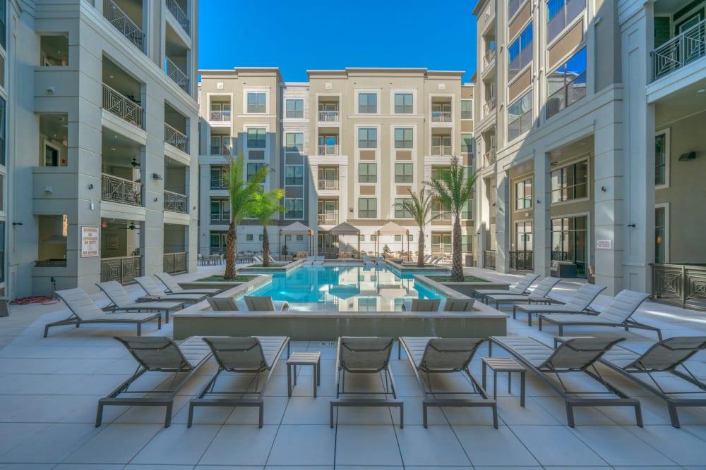 Luxury swimming pool at The Hamilton Apartments in Houston, Texas