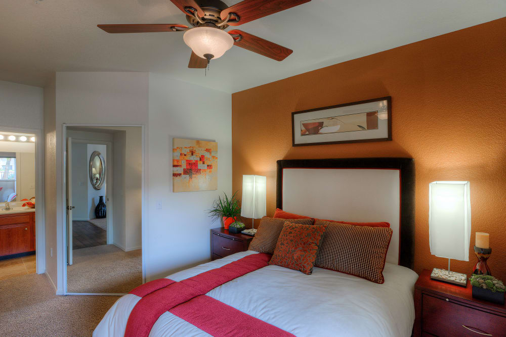 Large master bedroom with ceiling fan and beautiful furnishings in model home at San Marbeya in Tempe, Arizona
