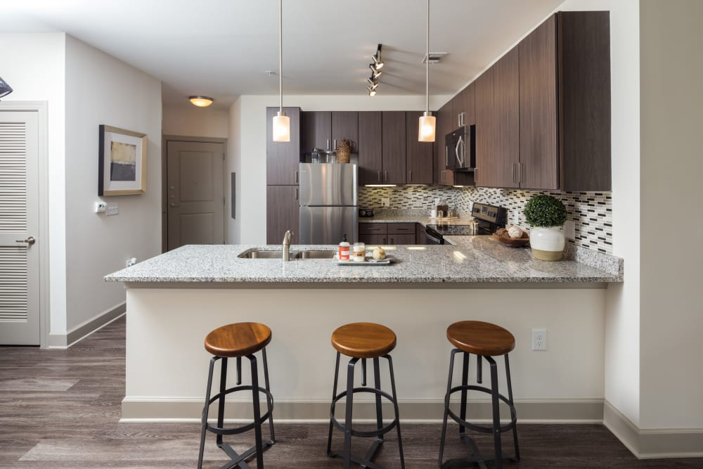 Modern kitchen with breakfast bar at One Metrocenter in Nashville, Tennessee