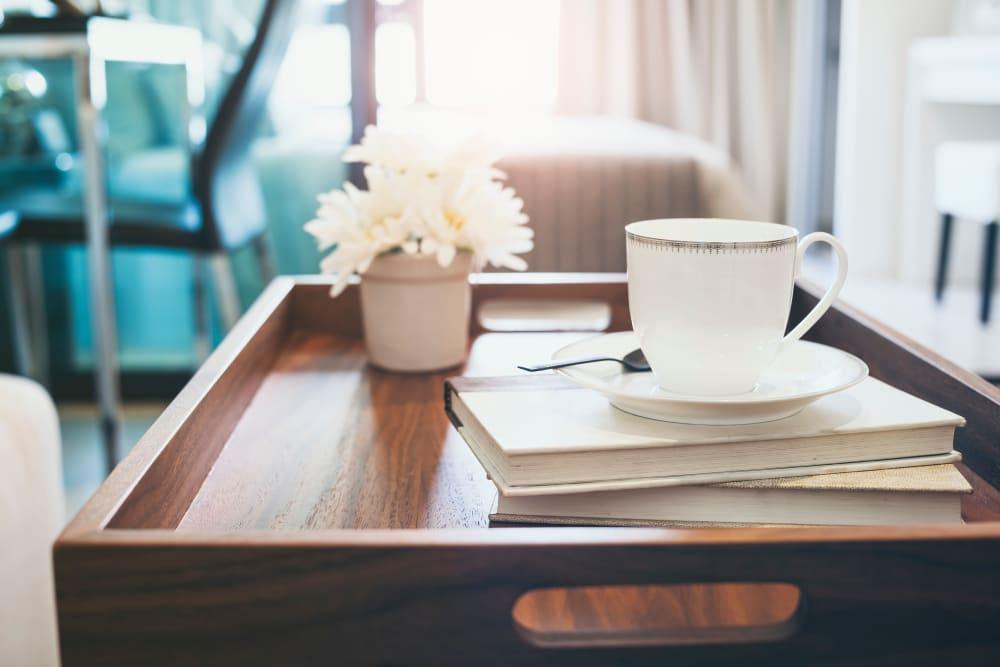 Coffee and books on a tray at Randle Hill Apartments in Washington, District of Columbia