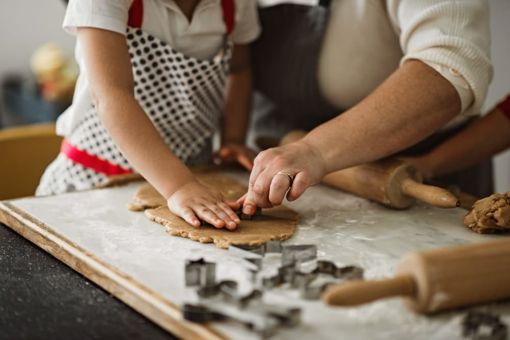 Family making gingerbread cookies at Randle Hill Apartments in Washington, District of Columbia