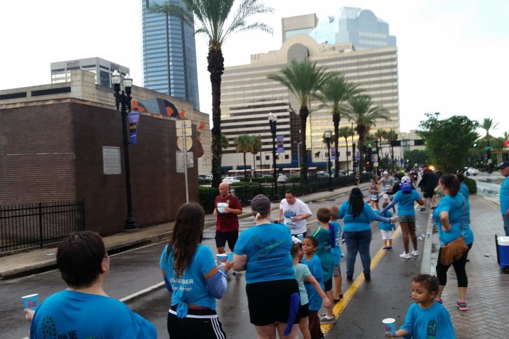 City-wide marathon with runners and walkers near WRH Realty Services, Inc