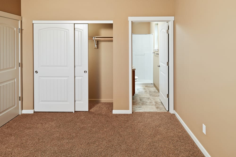 Master bedroom with closet and bathroom at Orchard Ridge in Salem, Oregon