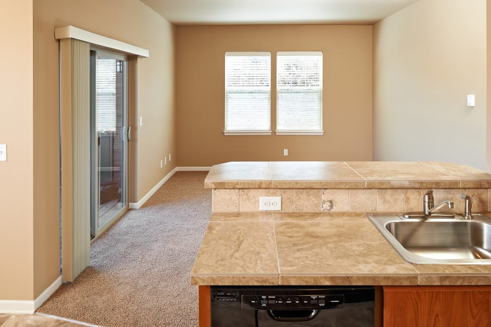 Beautiful kitchen and spacious living room at Orchard Ridge in Salem, Oregon