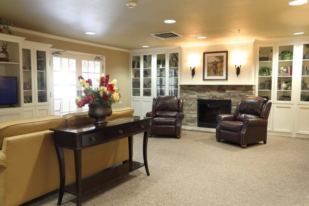 clubhouse living room with chimney at Mill Creek Alzheimer's Special Care Center in Springfield, IL