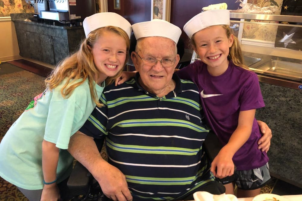 A resident and his granddaughters at The Willows at Hamburg in Lexington, Kentucky