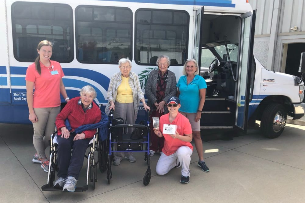 Residents in front of the community bus at The Willows at Hamburg in Lexington, Kentucky
