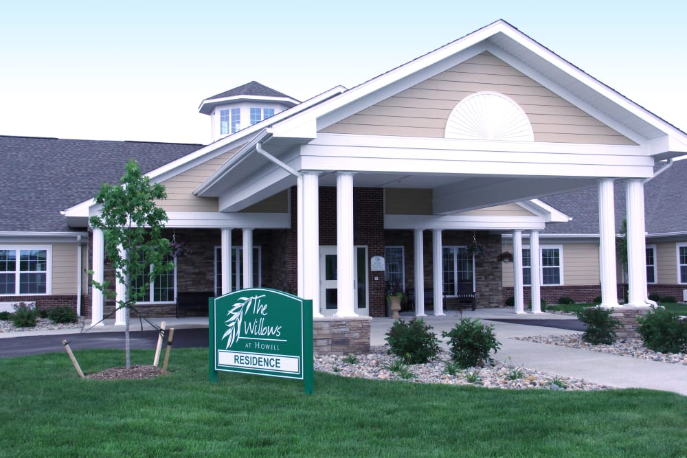 Building exterior and main entrance at The Willows at Howell in Howell, Michigan