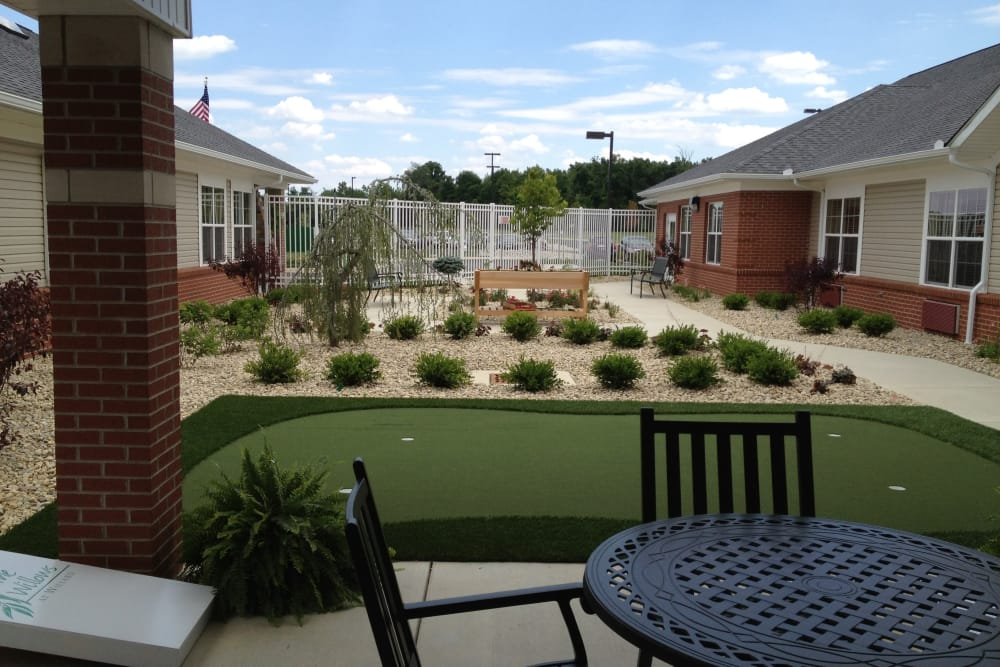 Covered seating and a mini golf course for residents at The Willows at Willard in Willard, Ohio