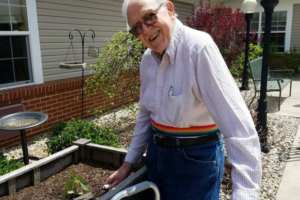 A resident gardening in the planter box at The Willows at Willard in Willard, Ohio