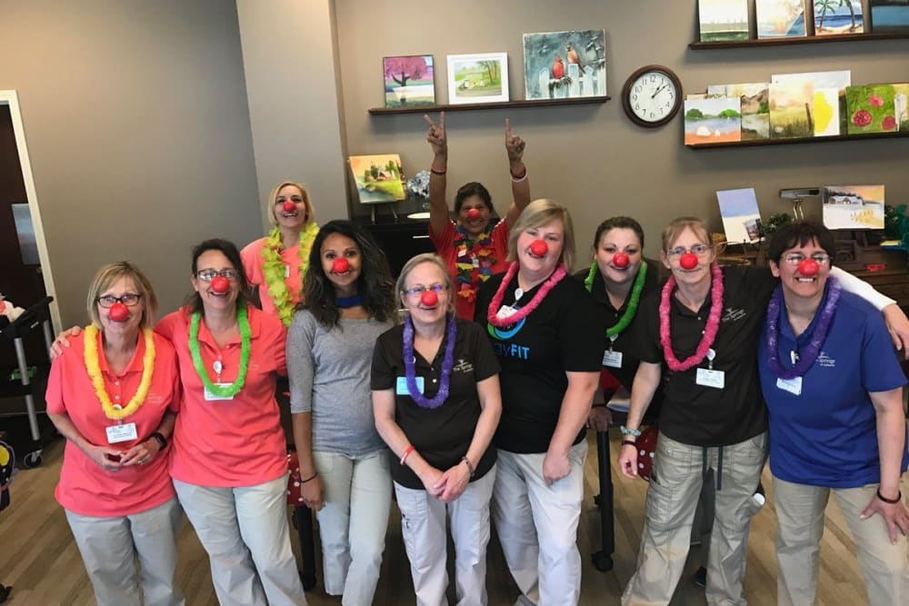 Silly staff posing for a photo in clown noses at The Springs at Lafayette in Lafayette, Indiana