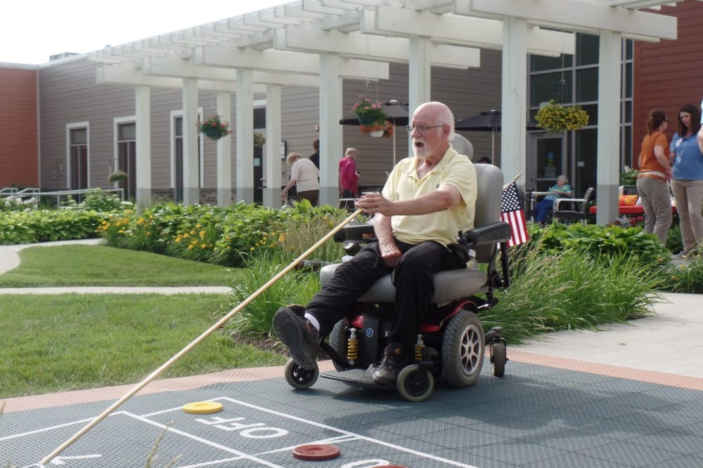 Resident playing a game outdoors at The Springs at Lafayette in Lafayette, Indiana