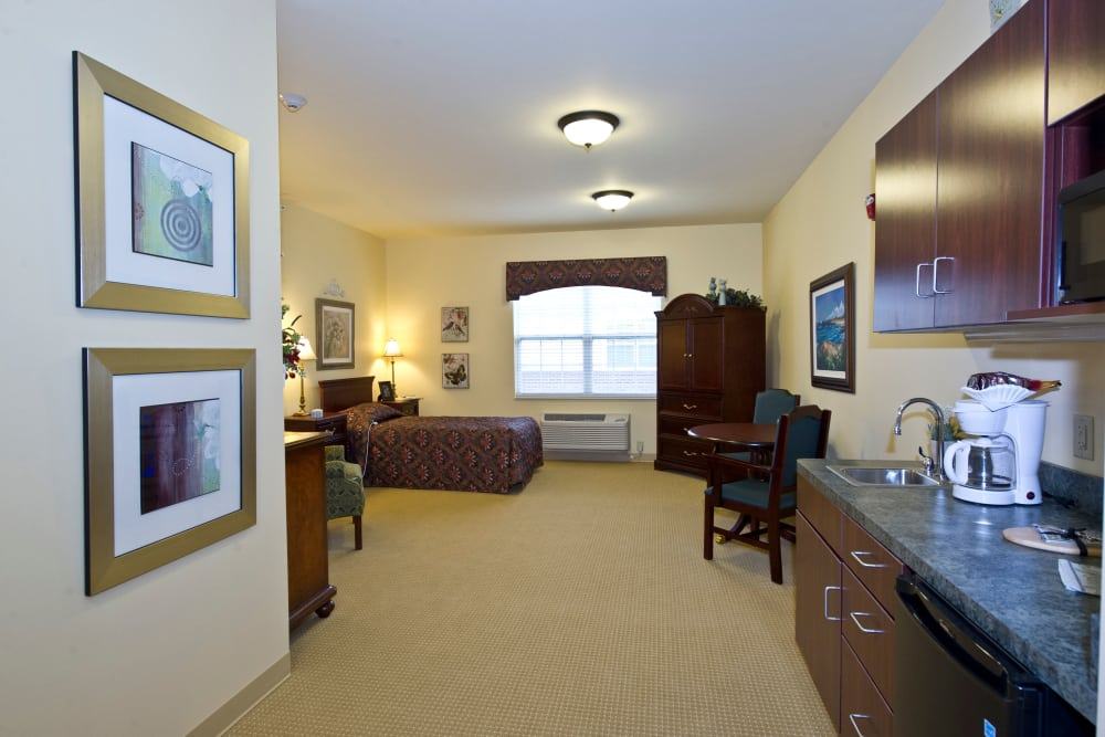 Apartment kitchen and bedroom at Westlake Health Campus in Commerce Township, Michigan