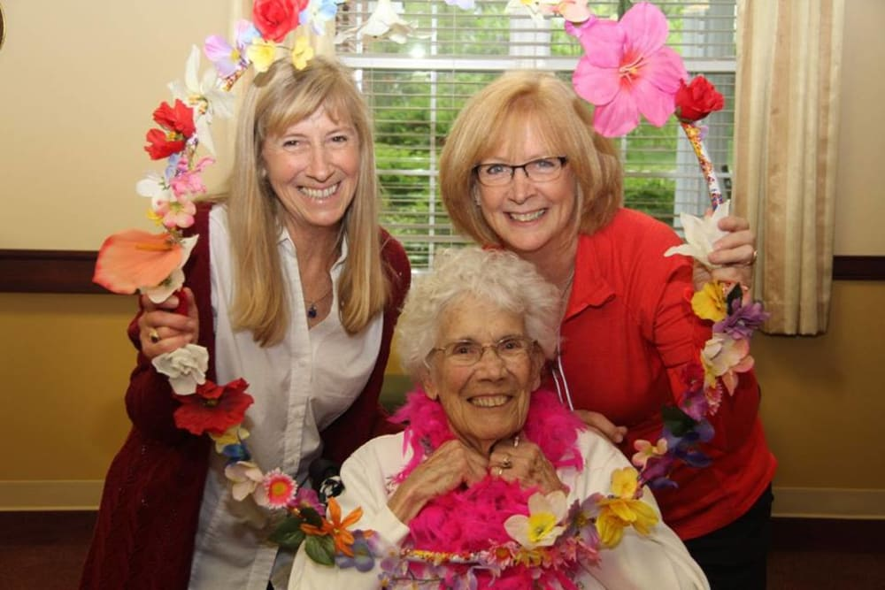 Residents posing for a photo with flowers at Westlake Health Campus in Commerce Township, Michigan