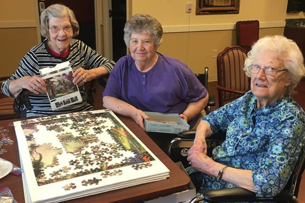 Female residents solving a puzzle in the common room at The Meadows of Ottawa in Ottawa, Ohio