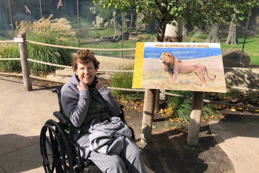 A happy resident from Novi Lakes Health Campus in Novi, Michigan at a zoo