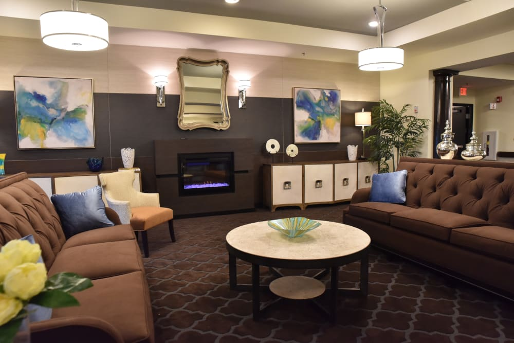 Comfortable fireside lounge at Orchard Pointe Health Campus in Kendallville, Indiana