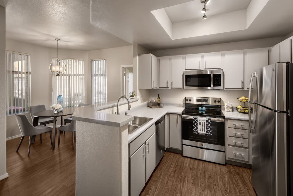 Beautiful open-concept floor plan with hardwood floors in model home at Bellagio in Scottsdale, Arizona