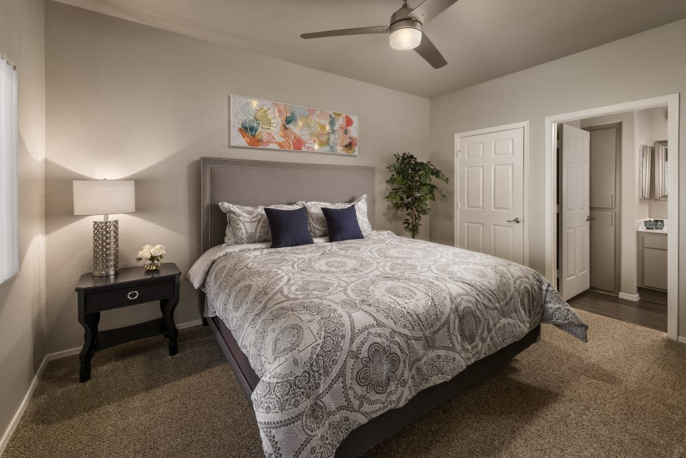 Large master bedroom with ceiling fan and beautiful furnishings in model home at Bellagio in Scottsdale, Arizona