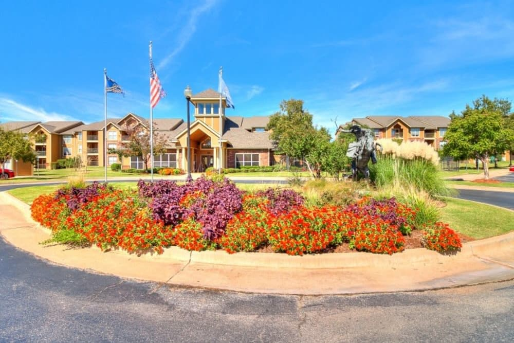 Flowers planted in front of clubhouse entrance at Pebble Creek in Mustang, Oklahoma