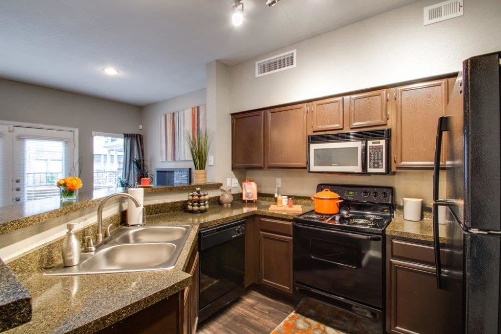 Fully equipped kitchen at Watermarke Apartments in Fort Worth, Texas