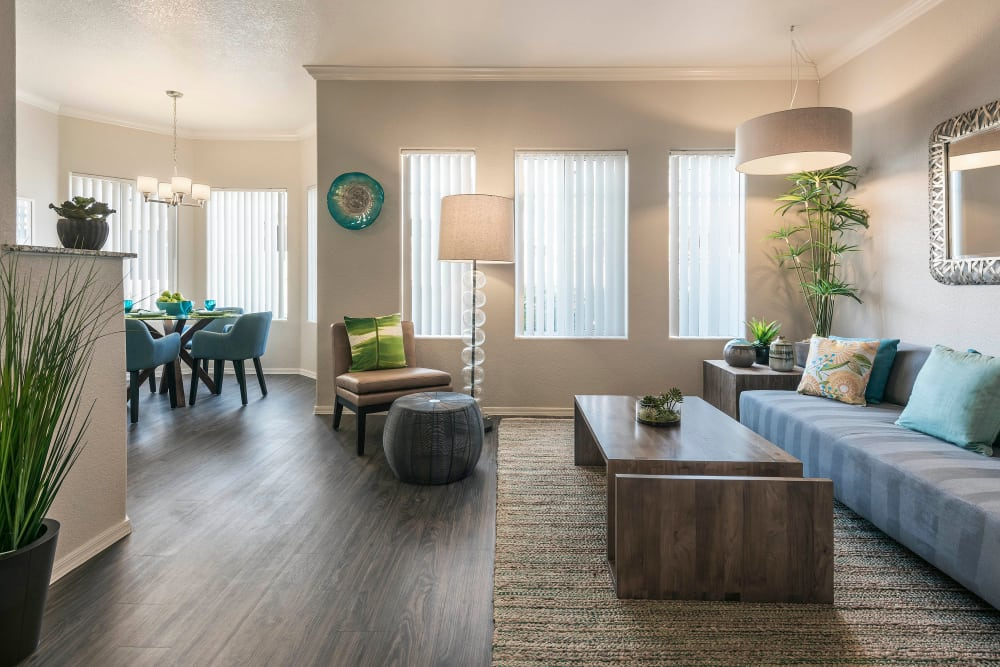 Beautiful open-concept floor plan with hardwood floors in model home at Mira Santi in Chandler, Arizona