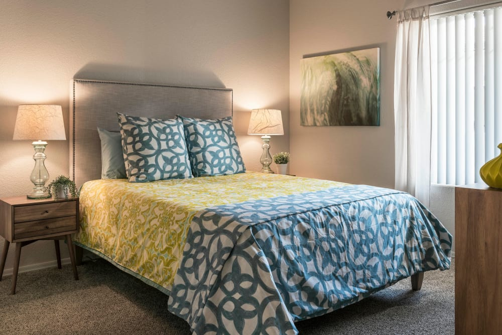 Large master bedroom with beautiful furnishings in model home at Mira Santi in Chandler, Arizona