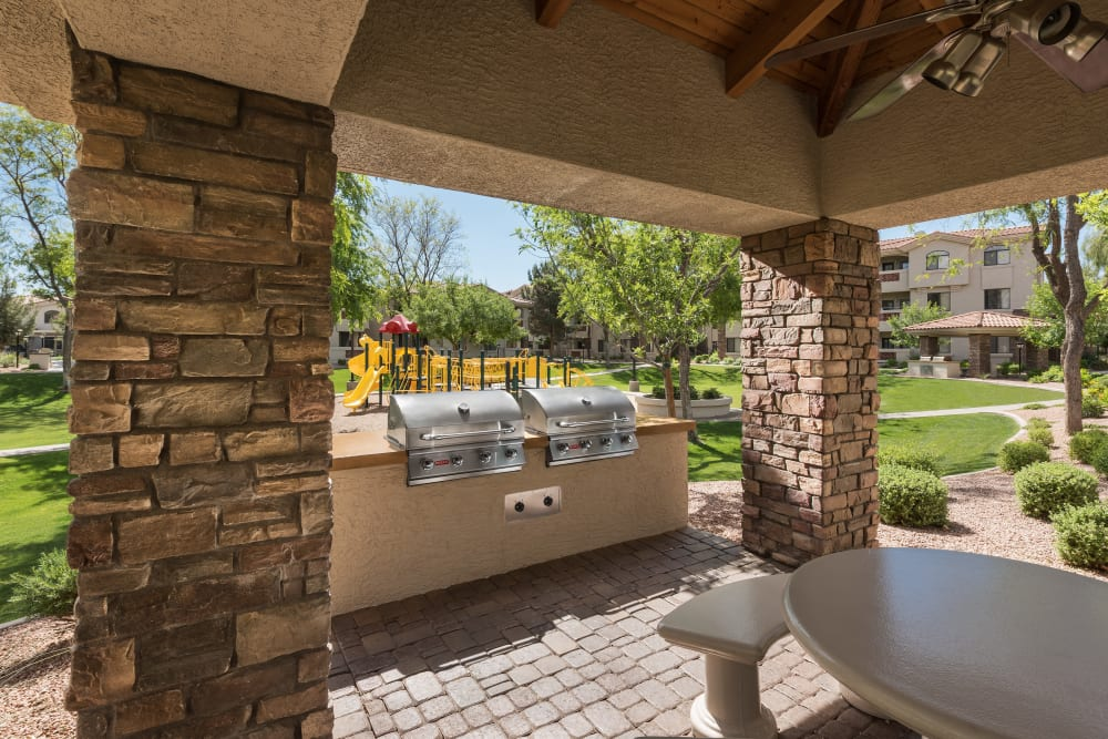 Family picnic area with BBQ and playground at San Hacienda in Chandler, Arizona