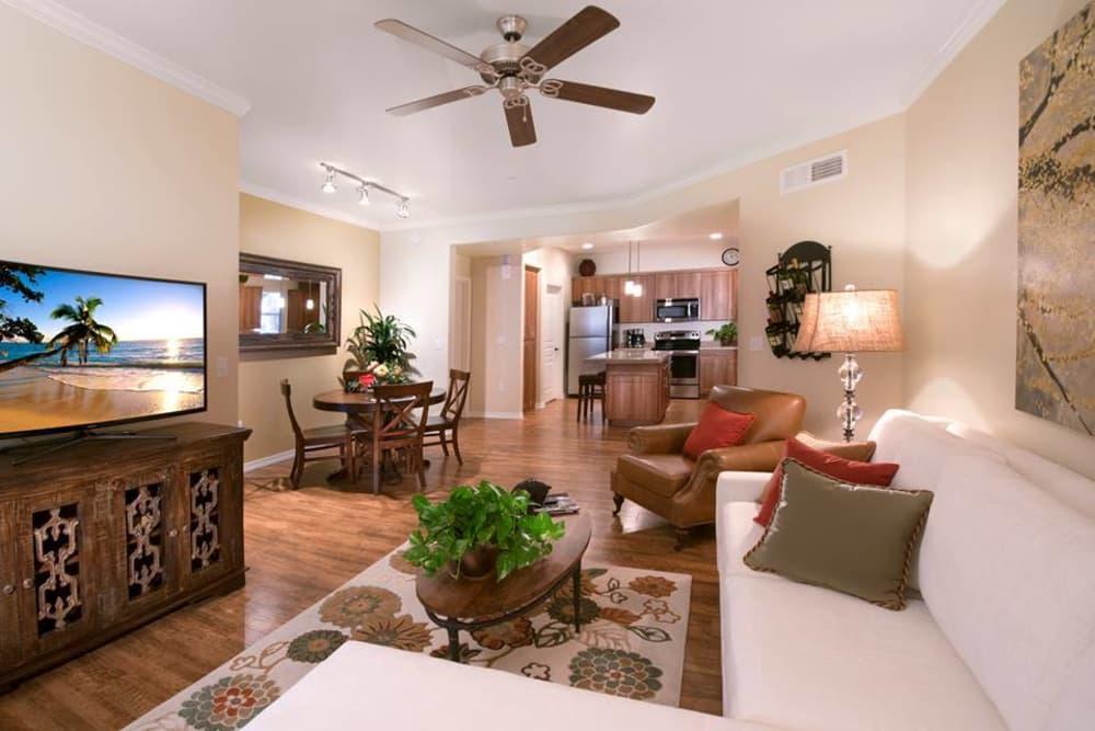 Beautiful open-concept floor plan with hardwood floors in model home at San Hacienda in Chandler, Arizona