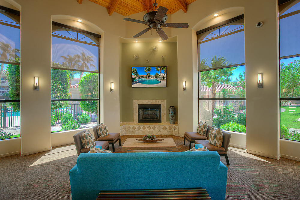 Luxurious clubhouse with a TV and fireplace at San Pedregal in Phoenix, Arizona