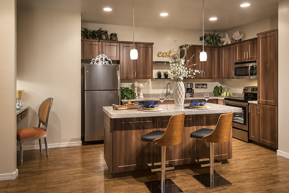 Beautiful, spacious kitchen with hardwood floors in model home at San Privada in Gilbert, Arizona