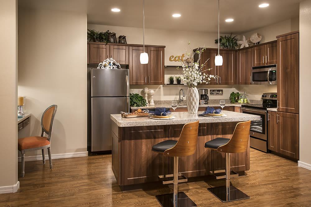 Beautiful open-concept floor plan with hardwood floors in model home at San Valencia in Chandler, Arizona