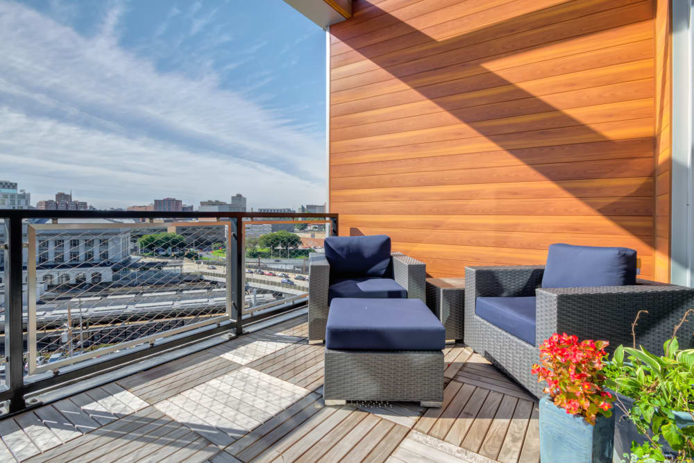 Outdoor patio at Nelson Kohl Apartments in Baltimore, Maryland