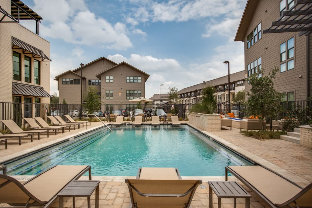 Poolside seating at Atwood at Ellison in Dallas, Texas
