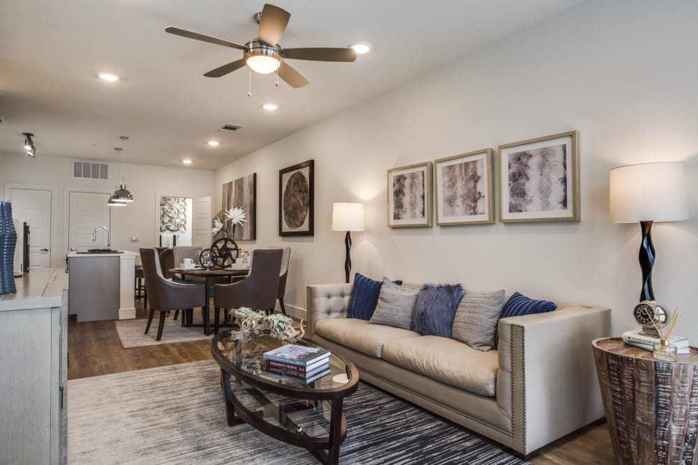 Living room with a ceiling fan at Atwood at Ellison in Dallas, Texas