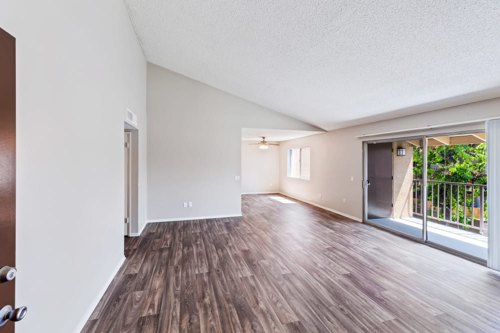 Open living area with hardwood floors at West Fifth Apartments in Ontario, California