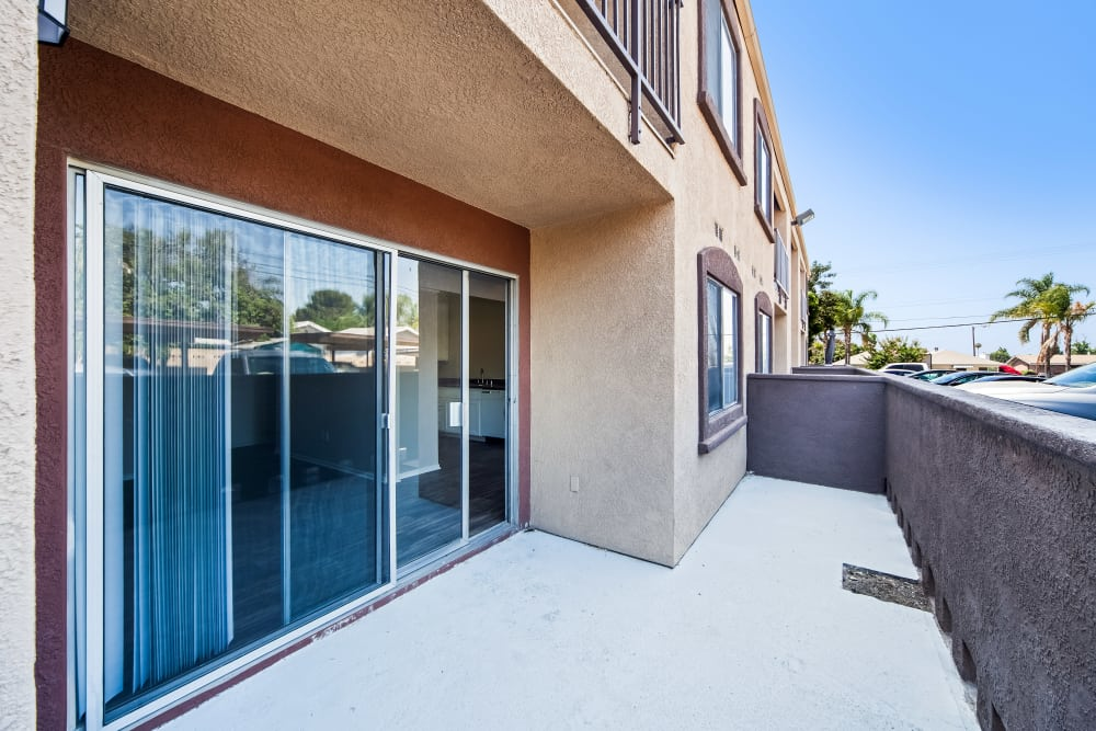 Back patio with sliding glass door at West Fifth Apartments in Ontario, California