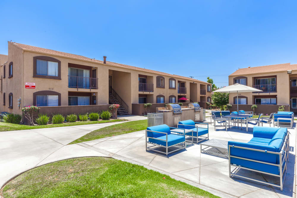Courtyard with barbecues and covered seating at West Fifth Apartments in Ontario, California