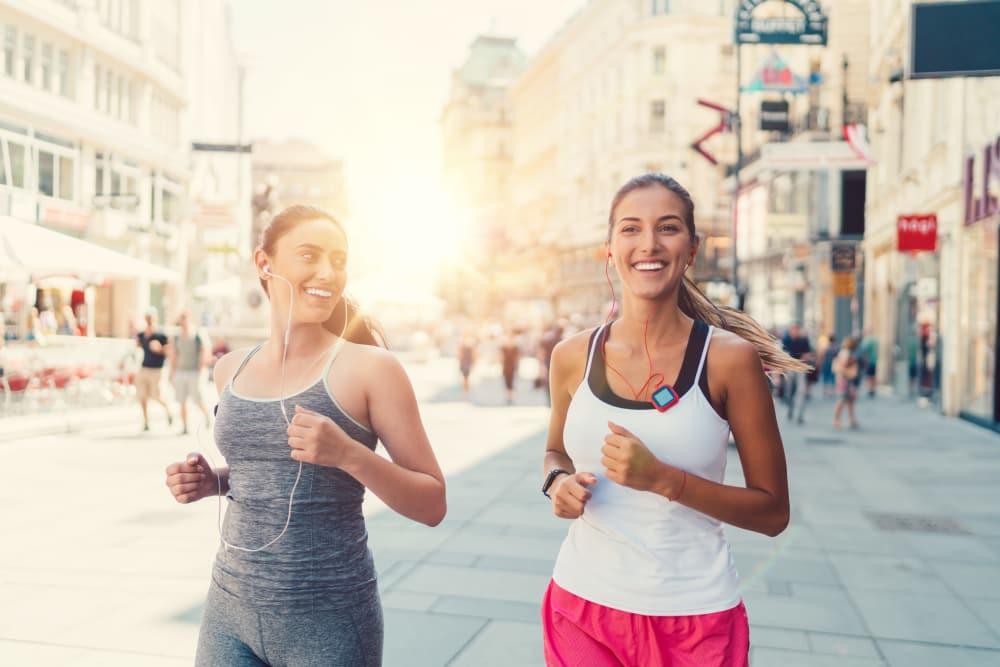 Residents jogging near Alta SoBo Station in Denver, Colorado