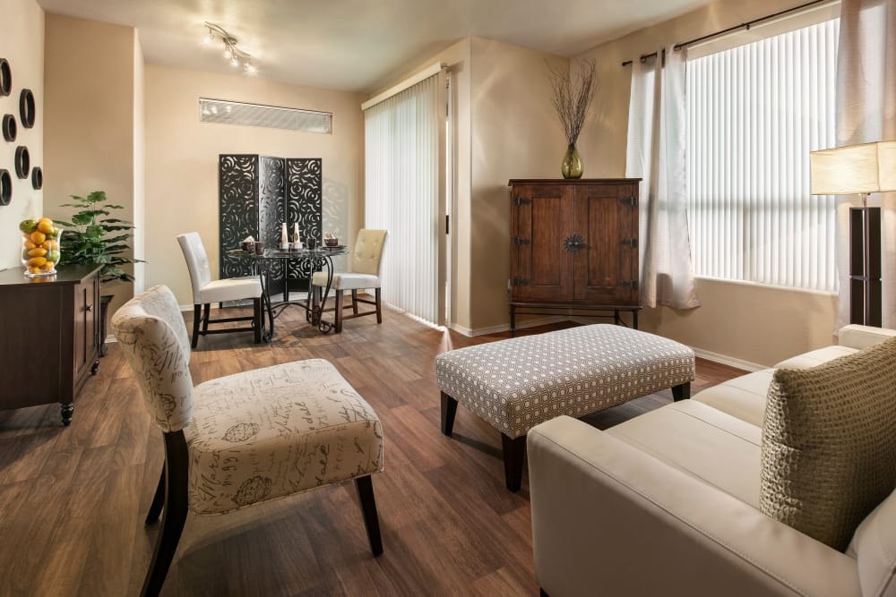 Beautiful open-concept floor plan with wood-style flooring in model home at Laguna at Arrowhead Ranch in Glendale, Arizona
