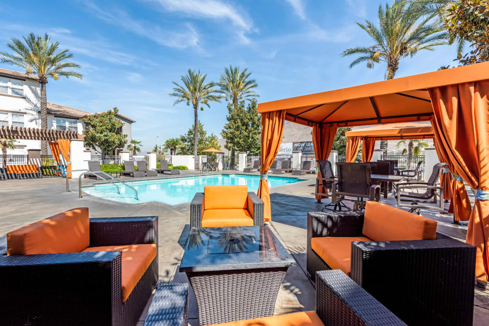 Comfortable poolside seating at Vista Imperio Apartments