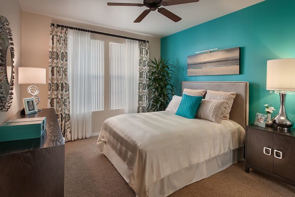 Large master bedroom with ceiling fan and beautiful furnishings in model home at San Norterra in Phoenix, Arizona