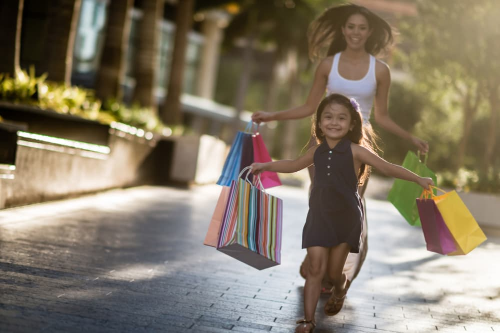 Happy mother and daughter shopping together in Washington, District of Columbia near Wheeler Terrace