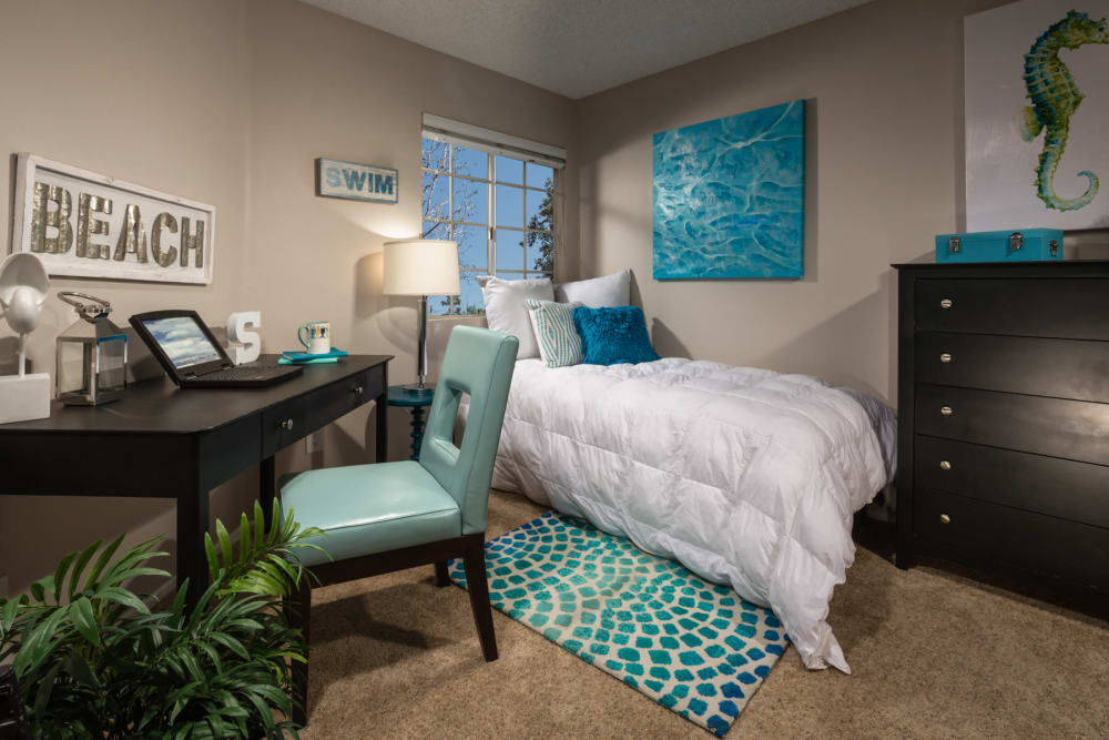 Spacious and decorated bedroom at Sierra Heights Apartments in Rancho Cucamonga, California