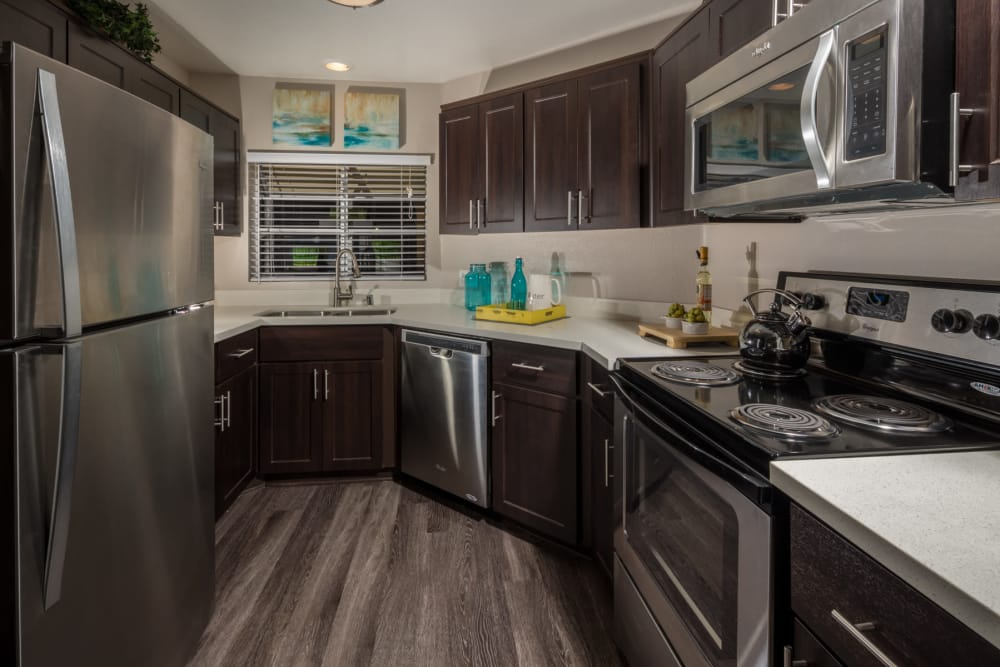 Private kitchen and modern appliances at Sierra Heights Apartments in Rancho Cucamonga, California